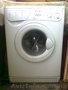 Белая стиральная машина indesit